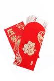 Bolsillo rojo y dinero afortunado en Año Nuevo chino Imágenes de archivo libres de regalías