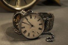 Bolsillo viejo y reloj moderno Foto de archivo libre de regalías
