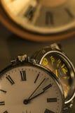 Bolsillo viejo y reloj moderno Imagen de archivo libre de regalías
