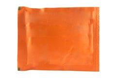 Bolsita anaranjada en el fondo blanco Imagen de archivo