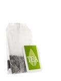 Bolsita de papel del té con la etiqueta verde Imagen de archivo libre de regalías