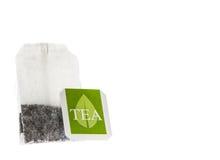 Bolsita de papel del té con la etiqueta verde Imagen de archivo