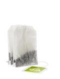Bolsita de papel del té con la etiqueta verde Imagenes de archivo
