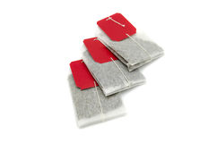 Bolsitas de té con las etiquetas rojas Imagen de archivo libre de regalías