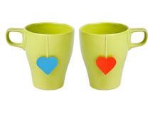 Bolsitas de té con los lables en forma de corazón Imagen de archivo libre de regalías