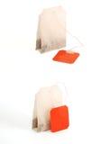 Bolsitas de té en el fondo blanco Imagenes de archivo