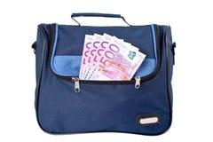 Bolso azul con el dinero Foto de archivo libre de regalías