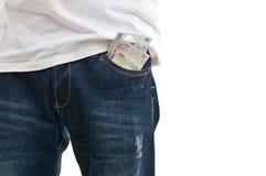 Bolso azul de brim com dinheiro Fotografia de Stock