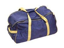 Bolso azul del recorrido con las manetas Imágenes de archivo libres de regalías