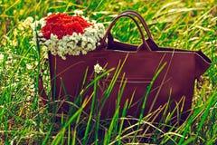 Bolso con las flores Fotografía de archivo