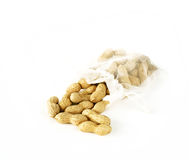 Bolso con los cacahuetes que caen Fotografía de archivo libre de regalías