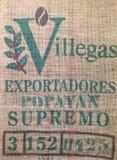 Bolso de café con el texto Imagen de archivo