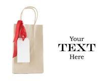 Bolso de compras con la etiqueta de la Navidad Foto de archivo libre de regalías