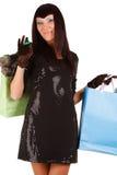 Bolso de compras de la mujer que lleva asiática joven Imagen de archivo
