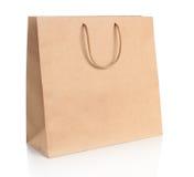 Bolso de compras de papel con las manijas imagenes de archivo