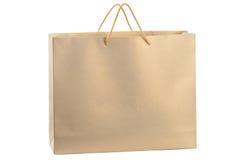 Bolso de compras de papel del oro Imagen de archivo libre de regalías
