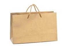 Bolso de compras de papel del oro Imágenes de archivo libres de regalías