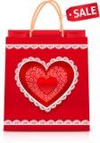 Bolso de compras de papel rojo del día de tarjetas del día de San Valentín Foto de archivo