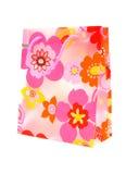 Bolso de compras plástico con adorno floral Imágenes de archivo libres de regalías