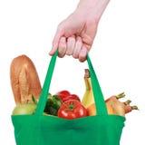 Bolso de compras reutilizable llenado de las frutas y verduras imagen de archivo