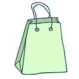 Bolso de compras verde con las manetas Gráfico del vector Panier ic Imagenes de archivo