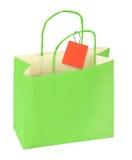 Bolso de compras verde y precio en blanco Imagen de archivo