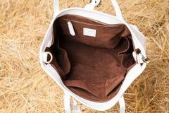 Bolso de cuero en heno del yelow Imagen de archivo libre de regalías