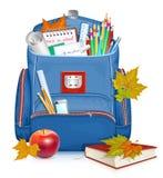 Bolso de escuela con los objetos de la educación Foto de archivo