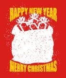 Bolso de la Feliz Navidad con los regalos Saco rojo grande de Santa Claus en g Foto de archivo libre de regalías