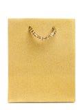Bolso de oro del regalo aislado Fotos de archivo