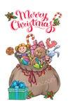 Bolso de Santa Claus con la tarjeta de Navidad de los regalos Fotos de archivo libres de regalías