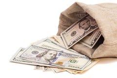 Bolso del dinero con los dólares Imagen de archivo