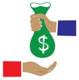 Bolso del dinero en una mano Imagenes de archivo