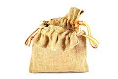 Bolso del saco de la arpillera en el fondo blanco Fotos de archivo