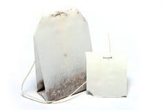 Bolso del té con la escritura de la etiqueta en blanco Fotos de archivo libres de regalías