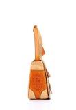 Bolso femenino de cuero en un fondo blanco Imagen de archivo