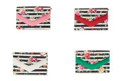 Bolso femenino del color en un background2 blanco Foto de archivo libre de regalías