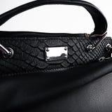 Bolso femenino negro foto de archivo