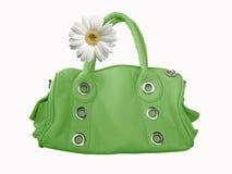 Bolso femenino verde con la flor imagenes de archivo