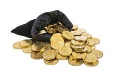 Bolso llenado de las monedas Foto de archivo libre de regalías