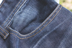 Bolso no fundo da forma das calças de brim Fotografia de Stock Royalty Free