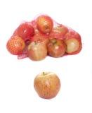 Bolso que se derrama encima con las manzanas Fotografía de archivo libre de regalías