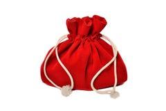 Bolso rojo con los regalos foto de archivo