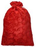 Bolso rojo de Santa Claus con los regalos Foto de archivo libre de regalías