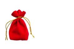 Bolso rojo del terciopelo aislado en blanco Fotos de archivo libres de regalías