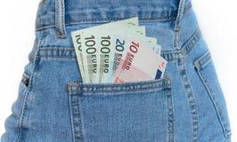 Bolso traseiro das calças de brim completamente de euro- cédulas imagem de stock