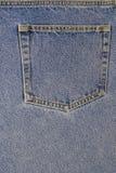 Bolso traseiro de um par de calças de brim imagens de stock royalty free