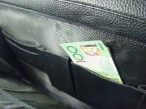 Bolso y dinero del asunto Imagenes de archivo
