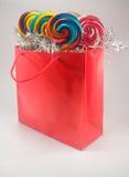 Bolso y lollipops del regalo Imagenes de archivo