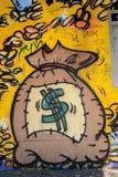 Bolso y monedas - pintada del dinero Fotos de archivo